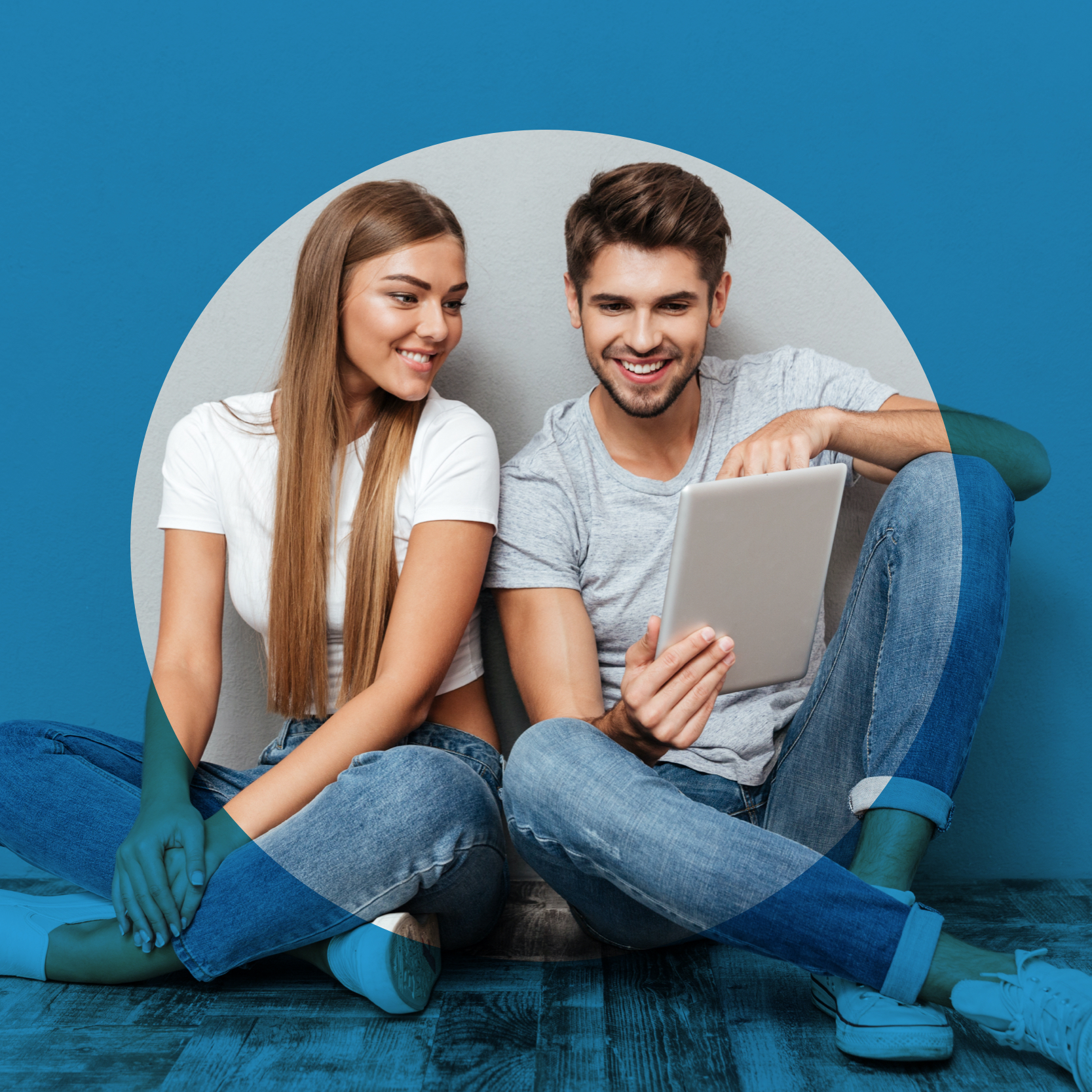 Happy couple with a tablet while girl looks in on a tablet